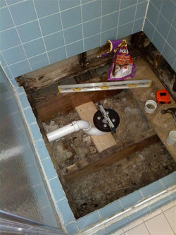 Stall shower pan leaks repaired