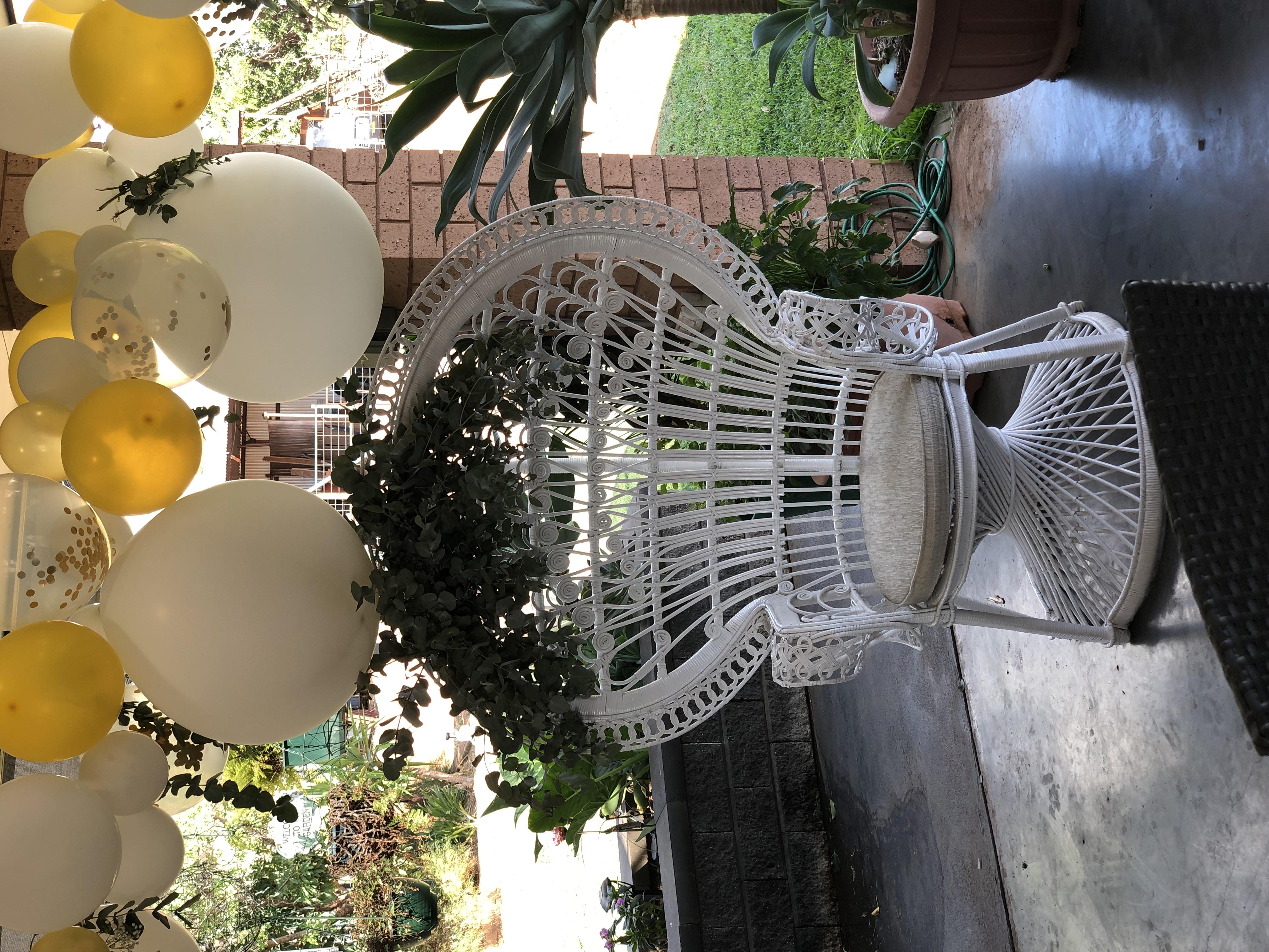 White peacock chair