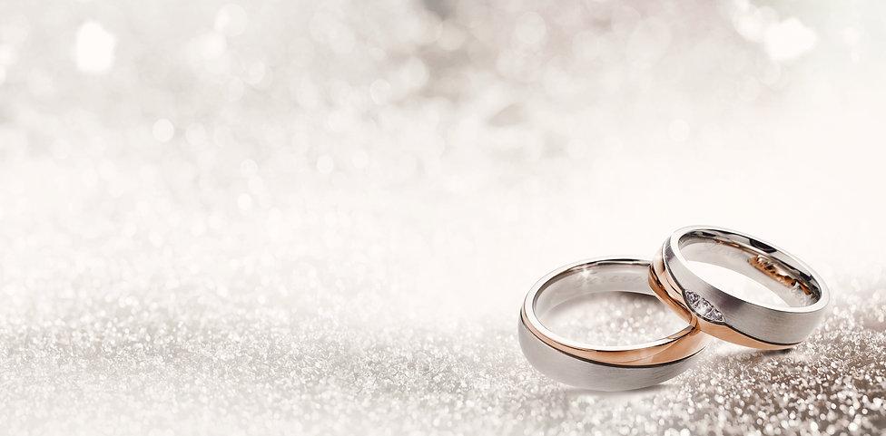 Designer wedding rings in the corner on