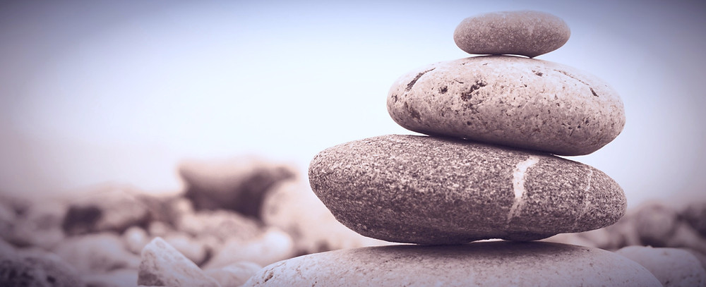 Zen stones serenity stones cairn is a word for stacking of natural stones
