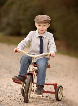 A boy and his tricycle