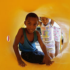 Boy Playing in a Tunnel