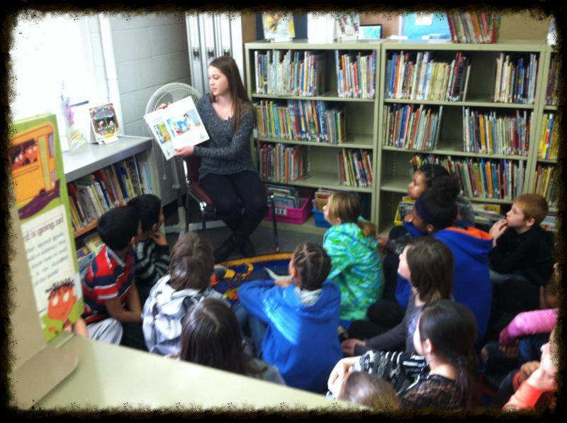 Rachael Cupp reads to students at Jane Adams Elementary School