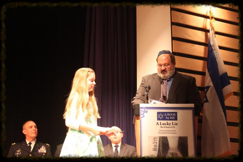 Young author Sydney Pearl receiving L'dor Vador  award from Stuart Oxer, Director,  Jewish Federation of Greater Des Moines