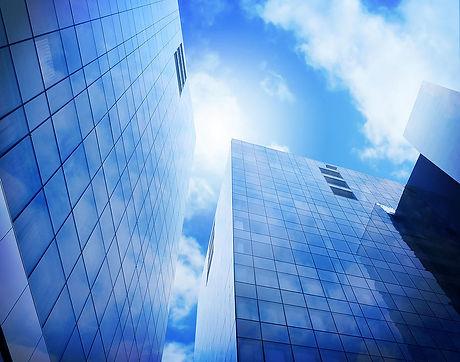bright-blue-city-buildings-with-clouds-angela-waye.jpg