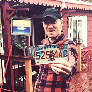 Happy to get my Alaskan license plate. Here the journey begins (Fairbanks).