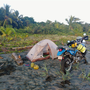 Camping on the black sandy beach of the Caribbean (Costa Rica)