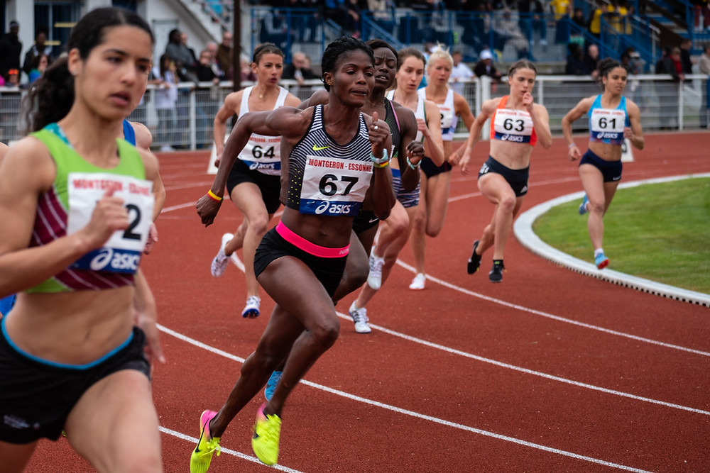 Diverse women competing in track and field race.jpg