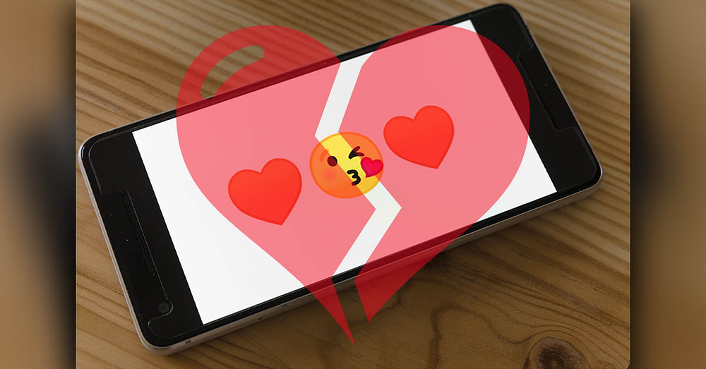 Broken heart over cellphone with kiss and love emojis