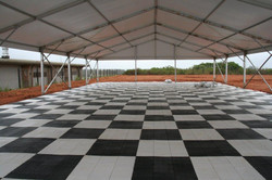 black and white checkered tent flooring.