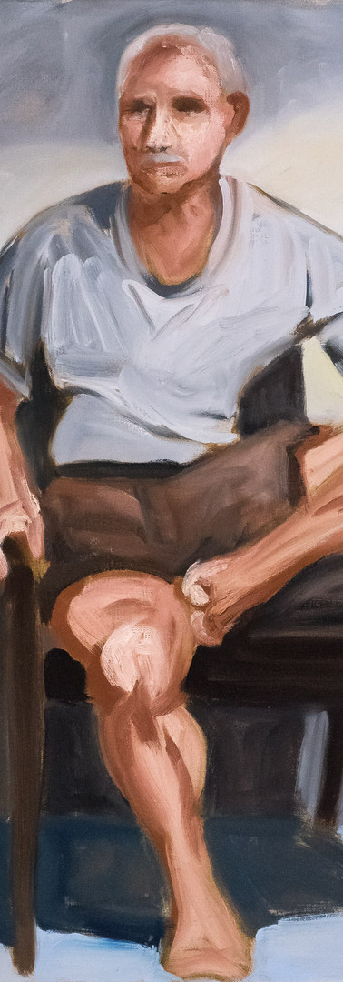 Seated Man in Shorts