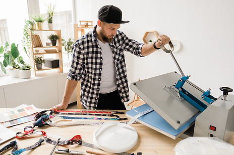 young-creative-man-printing-or-sticking-