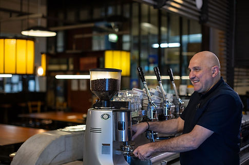 Cafe owner making coffee