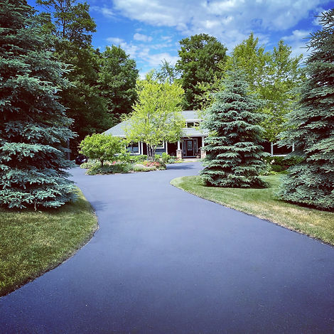 Asphalt sealcoating, crack repair, patching, and striping in Northern Michigan