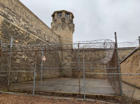 Solitary basketball court in prison yard. Chicago and Movies in Prison.