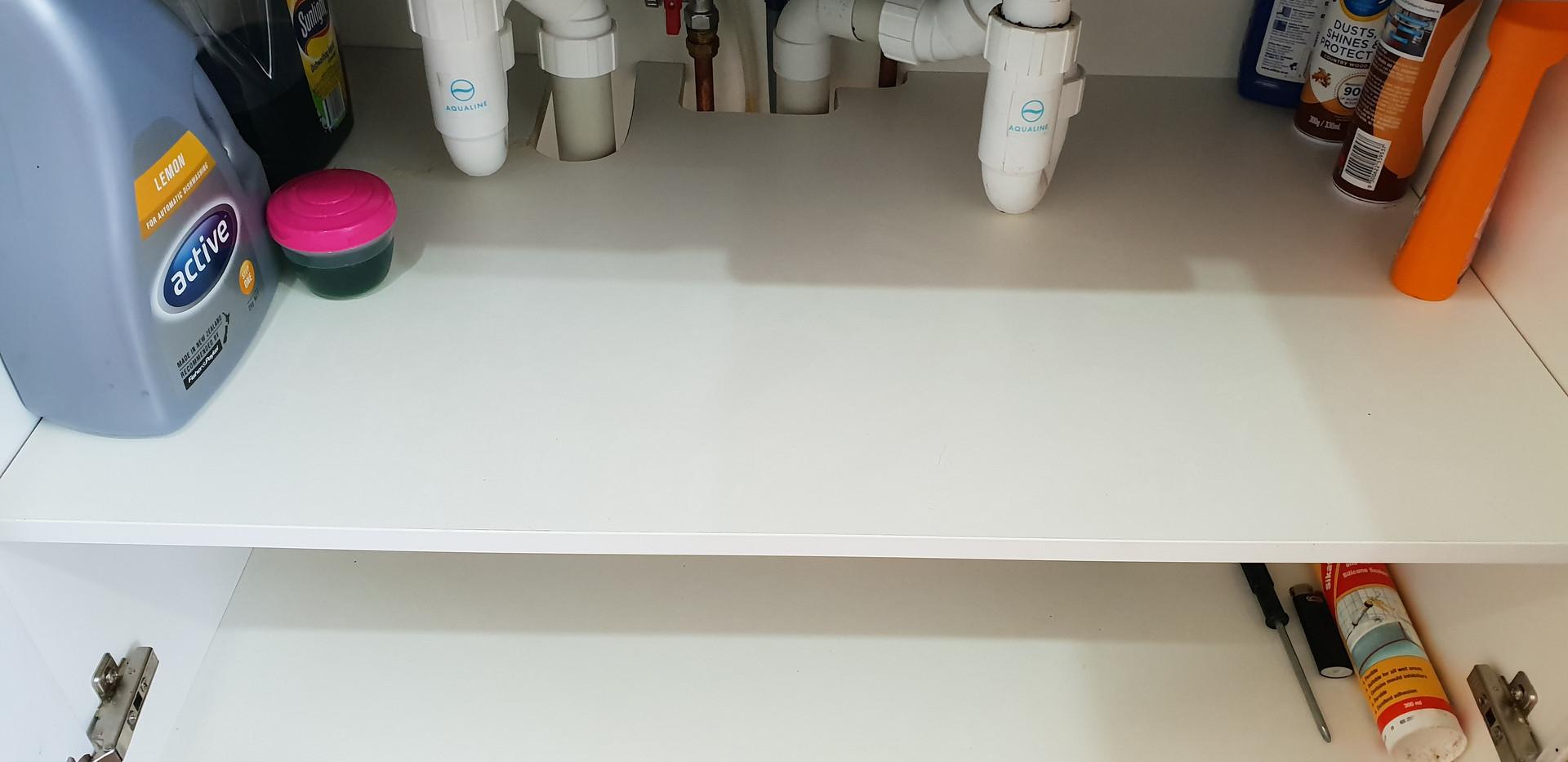 Kitchen cupboard after clean