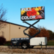 DKOI X portable digital sign with built in scissor lift and generator option