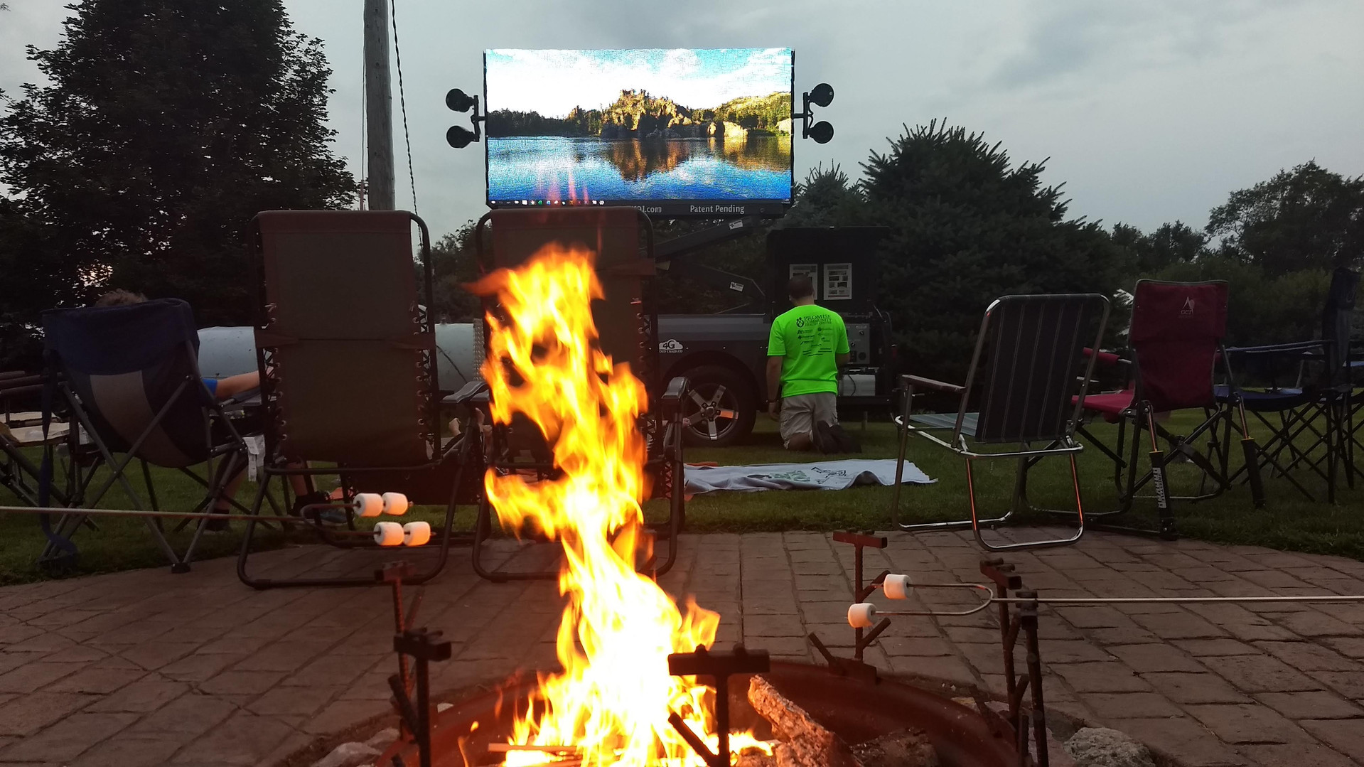 Multimedia movie night at camp fire