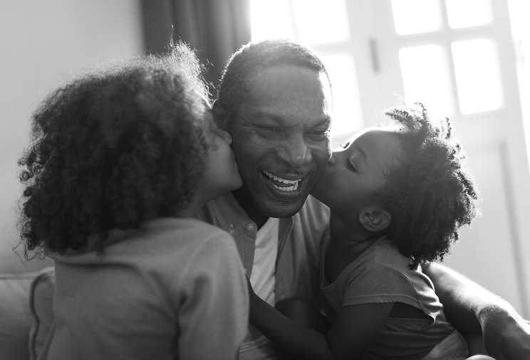 african-descent-family-home-kids-kissing
