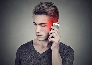 Man on the cellphone with headache. Upse