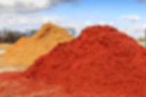 Red Mulch or Wood Chip Mound_ Mound of red mulch or wood chips use for landscaping top ground materi