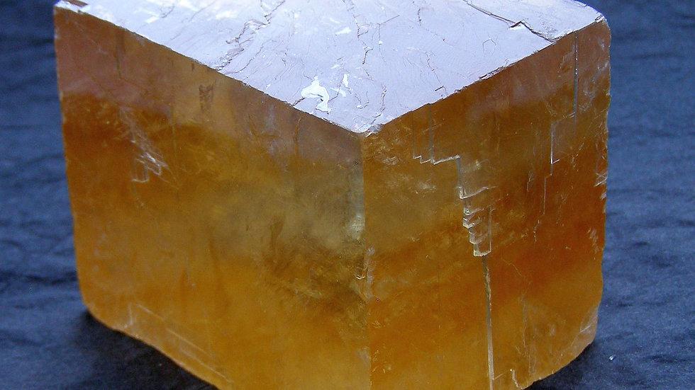 49mm x 42mm x 36mm (224g) Transparent Orange Calcite Crystal (Iceland Spar)