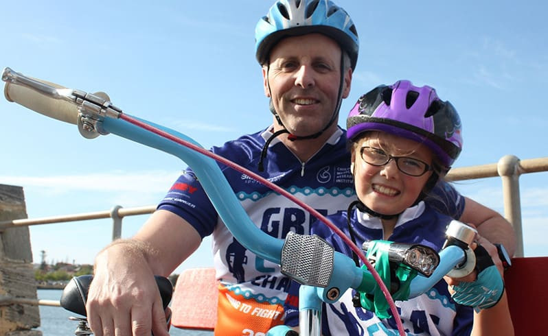 A young Imogen Kuipers and Andrew Kuipers riding for the GCC
