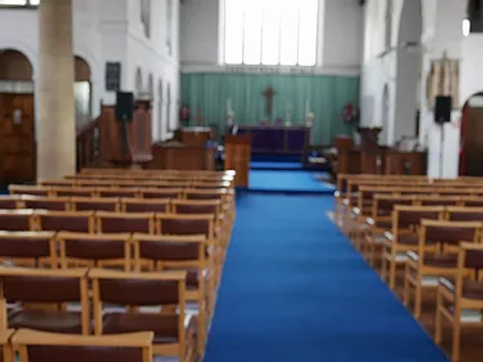 Inside view of St Elisabeth's CHurch showing the aisle and altar
