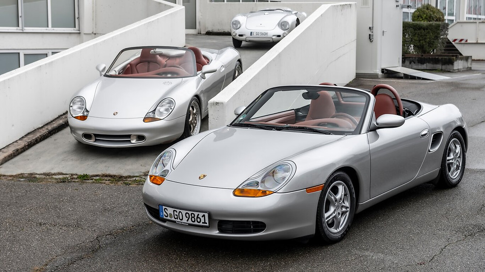 Boxster prototype (left) posed with the first generation car (right.)   Image by Porsche