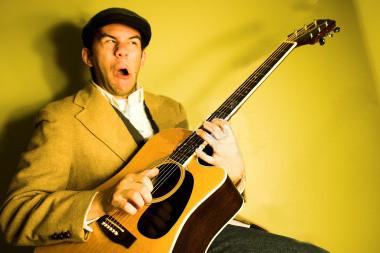 weird guitar player.jpg