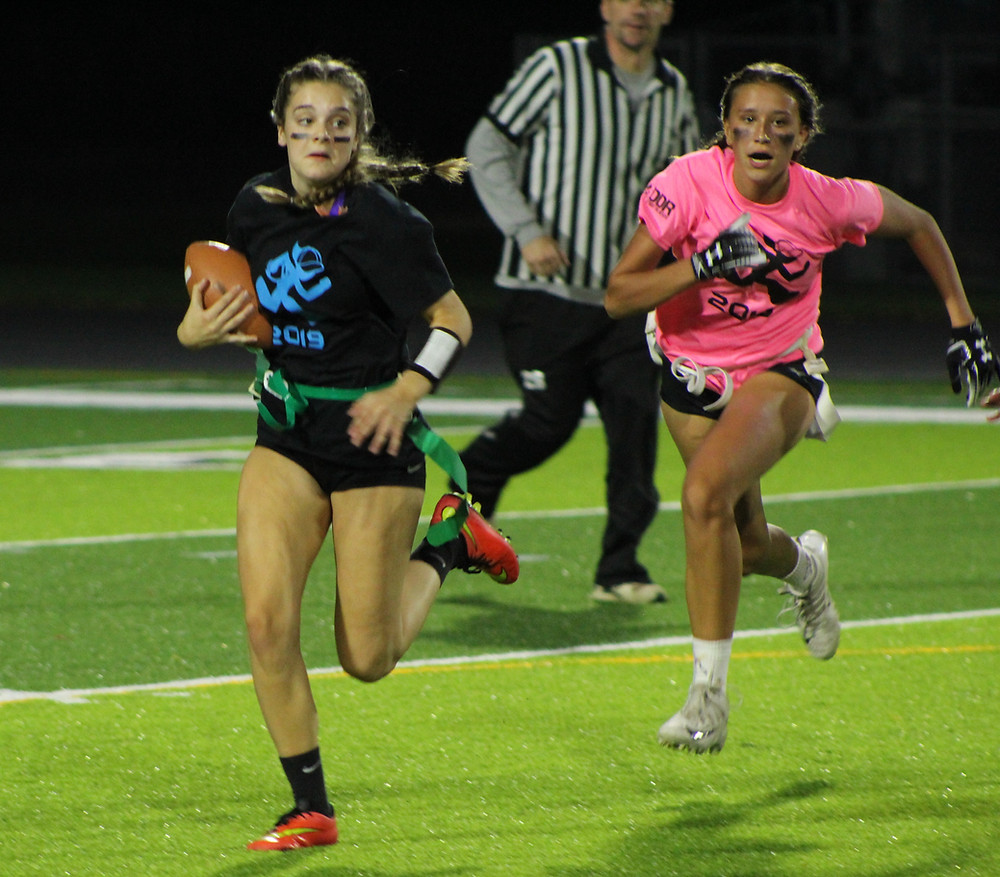 Senior Mia Yarberry, avoiding the defense as Junior Grace Hupp rushes down the line of scrimmage for the sack