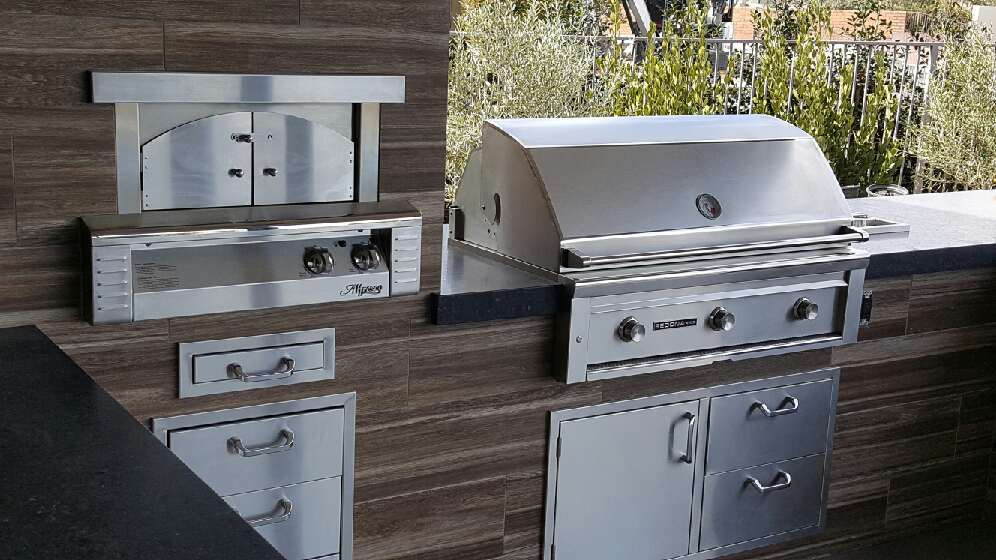 Outdoor Kitchen. Alfresco Pizza Oven, Lynx Grill, Tile, Stainless Steel  Inserts, Wood Grain Porcelain Tile.