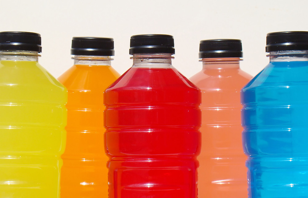 Range of yellow, orange, red and blue sports drinks