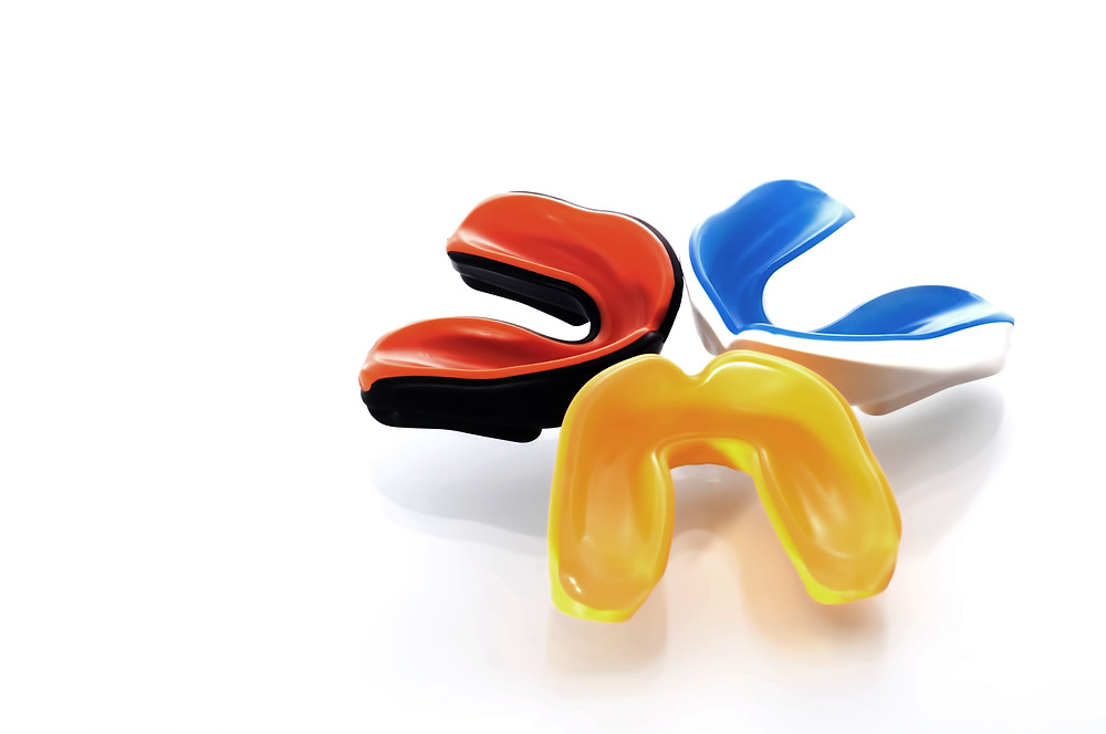 Red, blue and yellow mouth guards