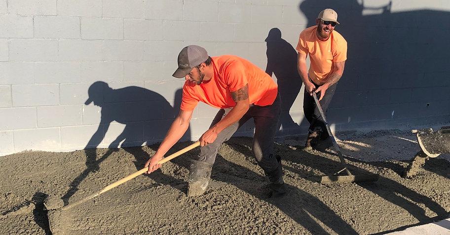 Pinnacle Site Solutions team members completing a sidewalk