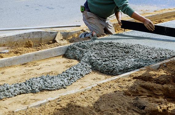 Pinnacle crew laying concrete sidewalk.