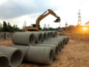 Focus on concrete pipes and backhoe to c