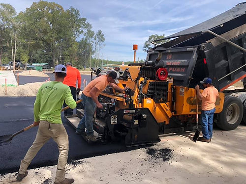 Pinnacle Site Solutions team pouring asphalt