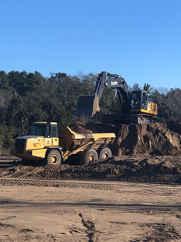 Pinnacle Site Solutions' employee working on an excavator.