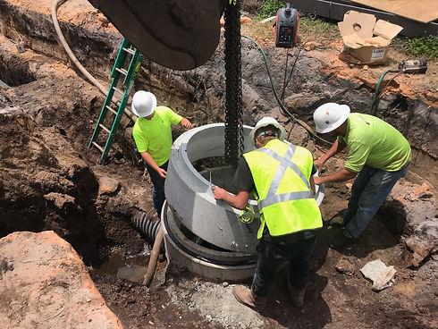 Pinnacle Site Solutions team members installing underground utilities