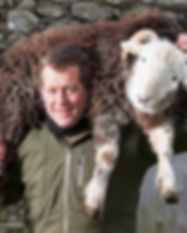 James-Rebanks-sheep-on-shoulder.jpg
