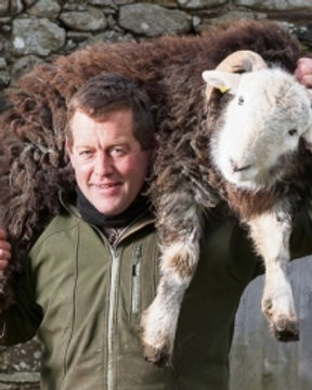 James-Rebanks-sheep-on-shoulder.jpg