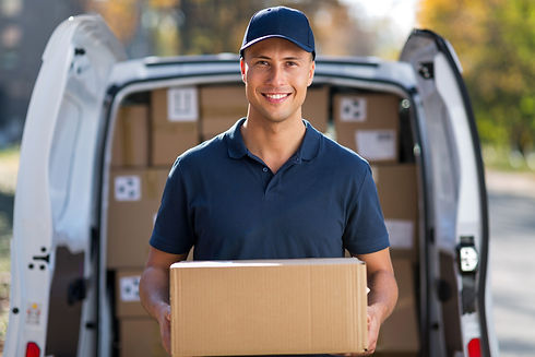 Smiling delivery man standing in front o