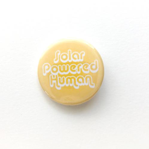 Solar Powered Human Pin Back Badge