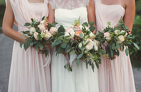 Foliage-rich-bouquets-held-by-bridesmaid