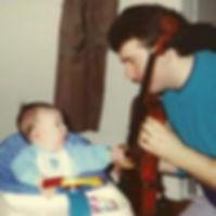 Adam interested in my viola.jpg