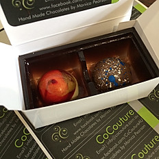 Two handmade chocolates in a box