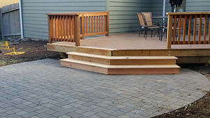 deck and flagstone patio