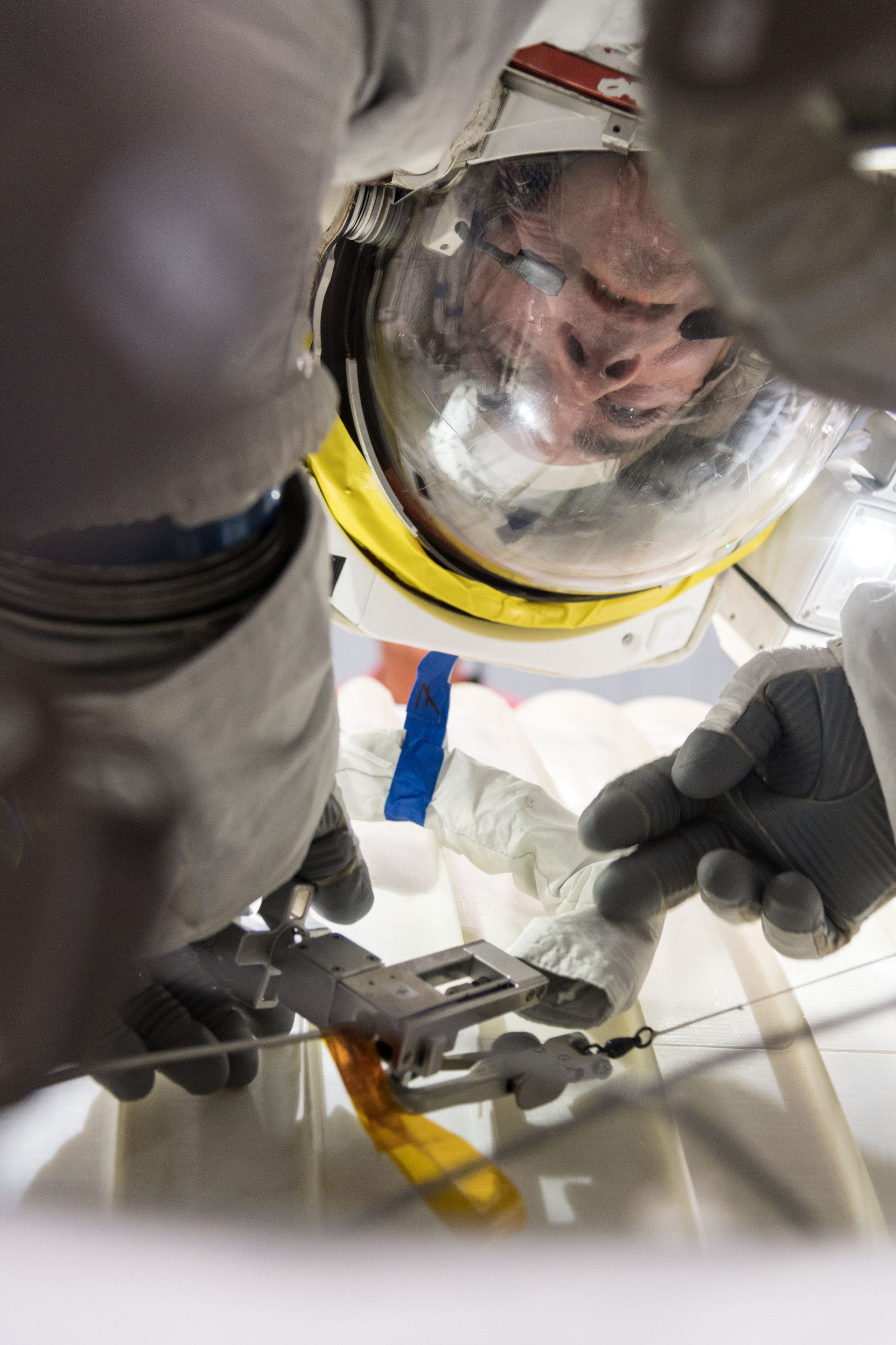Astronaut Chris Cassidy training in the Active Response Gravity Offload System (ARGOS) during a microgravity simulation.