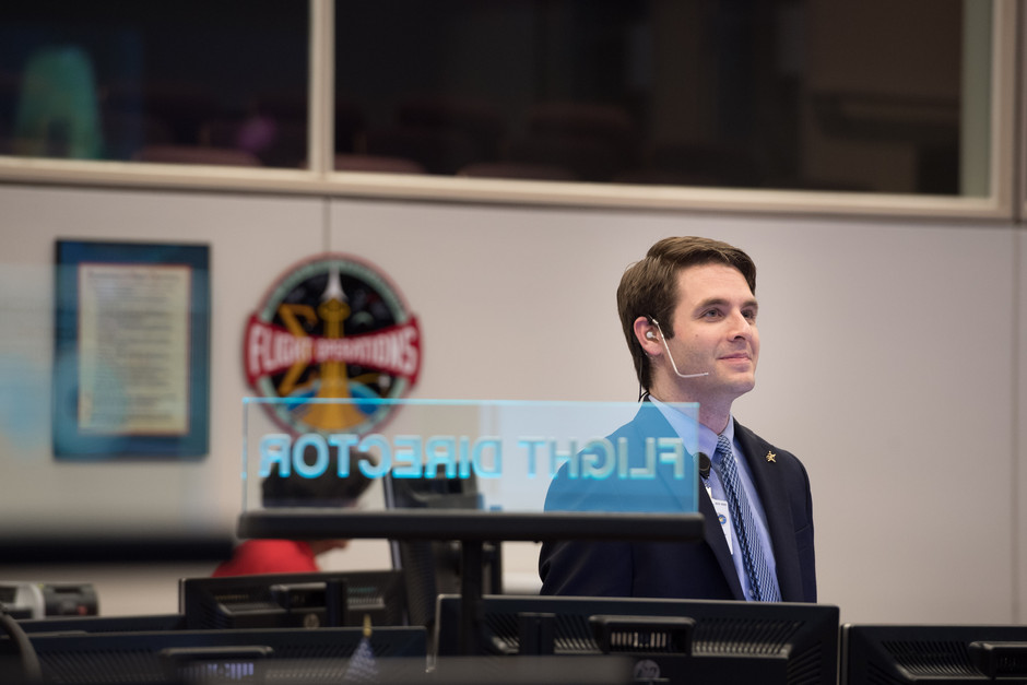 Flight Director Anthony Vareha in Misson Control during Rendezvous and Capture of the SpaceX/Dragon CRS-15 Cargo Craft to the nadir port of Harmony on ISS.